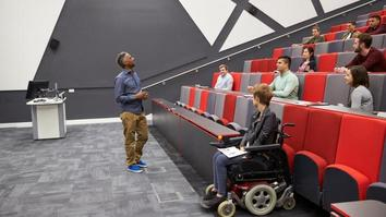 University lecture hall with student in wheelchair